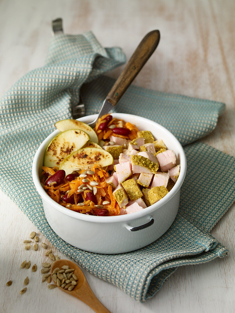 Potato and apple salad with kidney beans and turkey breast