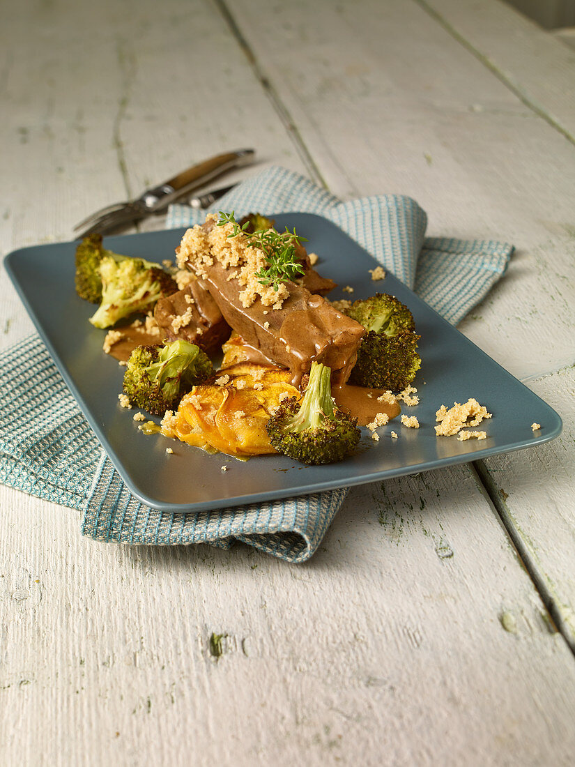 Leg of venison with sweet potato gratin and broccoli