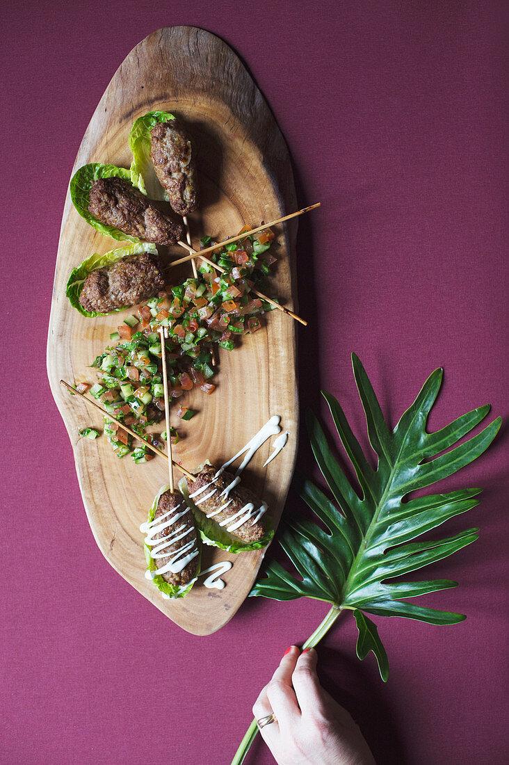 Israeli lamb köfte with sesame seed sauce (Levante cuisine)