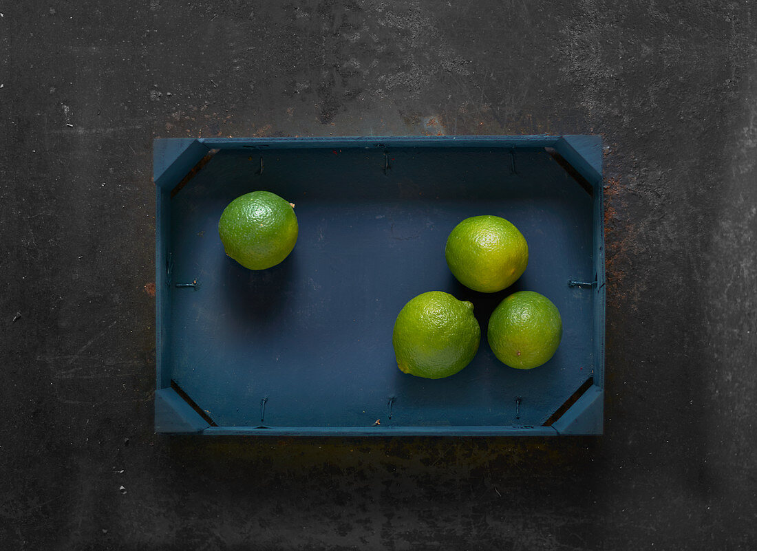 Limes in a wooden crate
