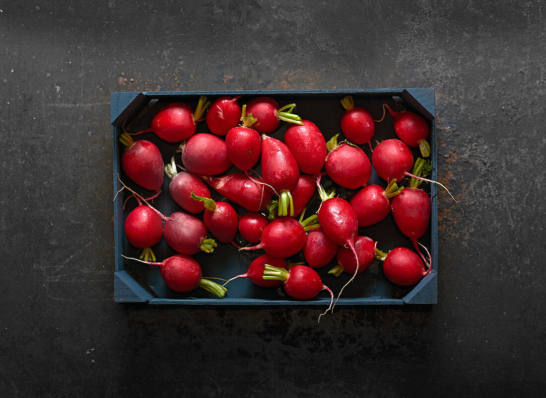 Radishes in a wooden crate