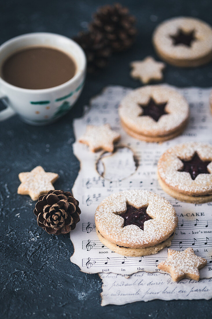 Christmas linzer cookies and a cup of coffee