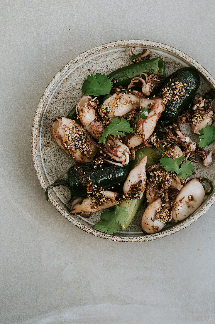 Calamari with green peppers, sesame seeds and spiced oil