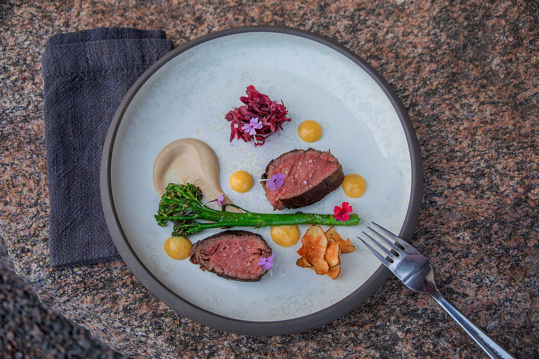Beef fillet, red cabbage pickled in red wine, artichoke crisps and broccoli