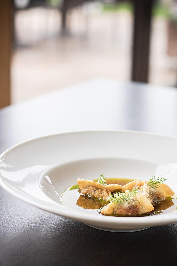 Dumplings with meat in broth