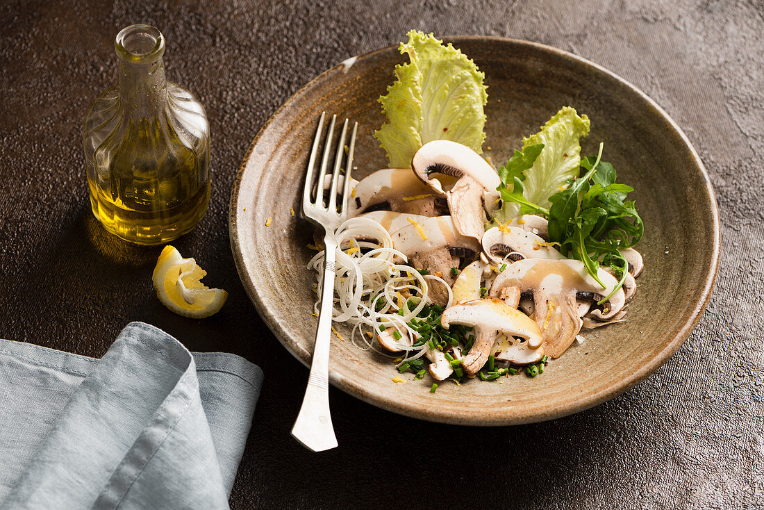 Mushroom salad with chives and spring onion and olive oil