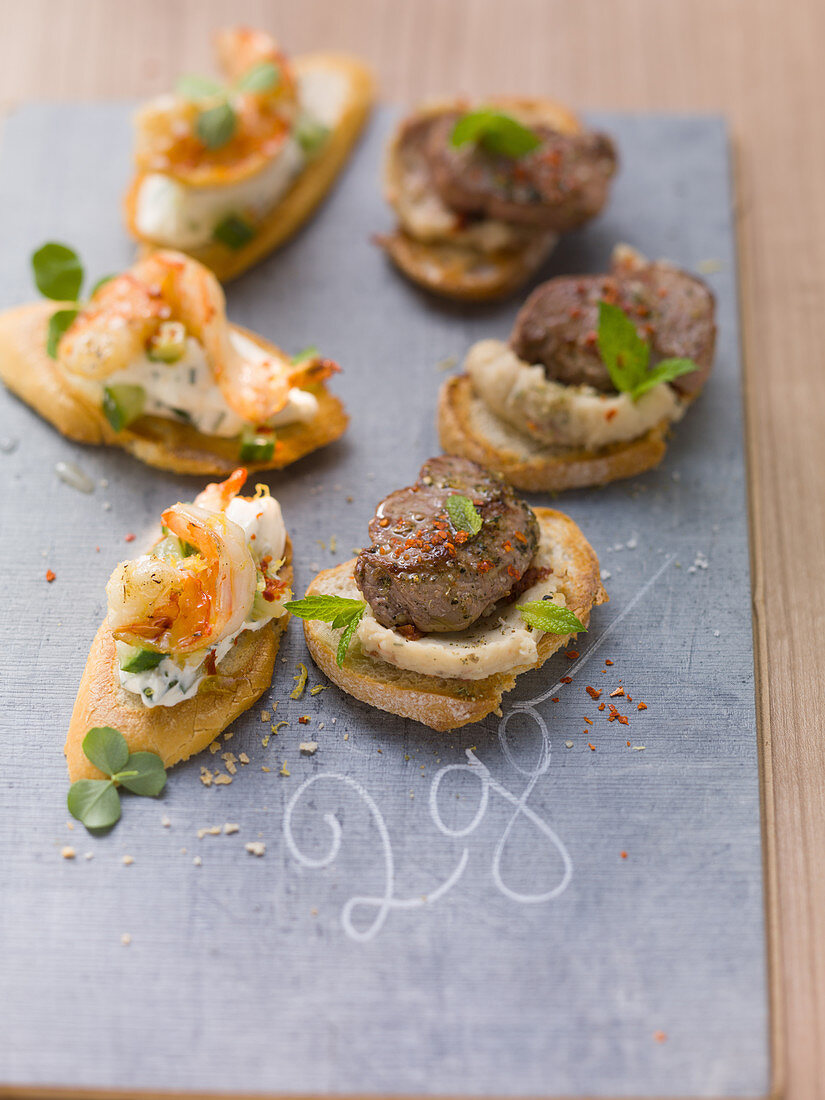 Crostini with lamb and shrimp