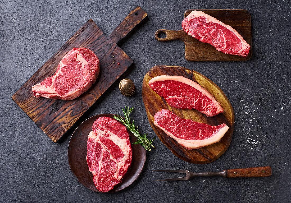 Top view variety of fresh Black Angus Prime raw beef steaks