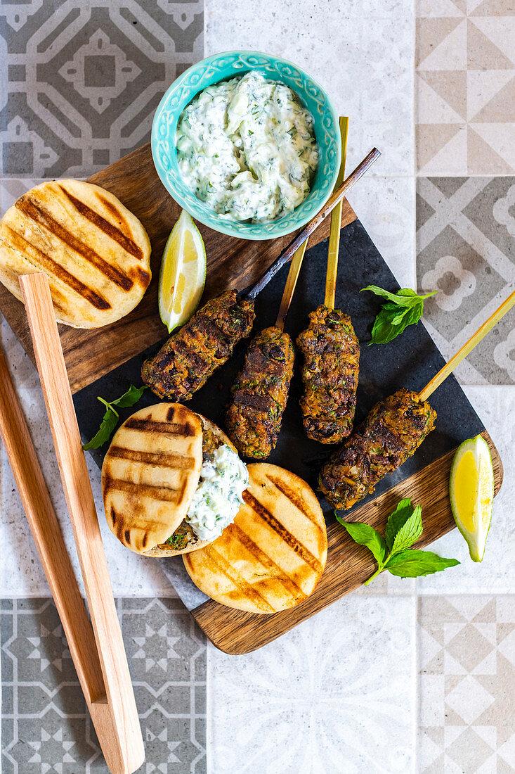 Moroccan-style chickpea keftas with lemon, mint raita and mini flatbreads