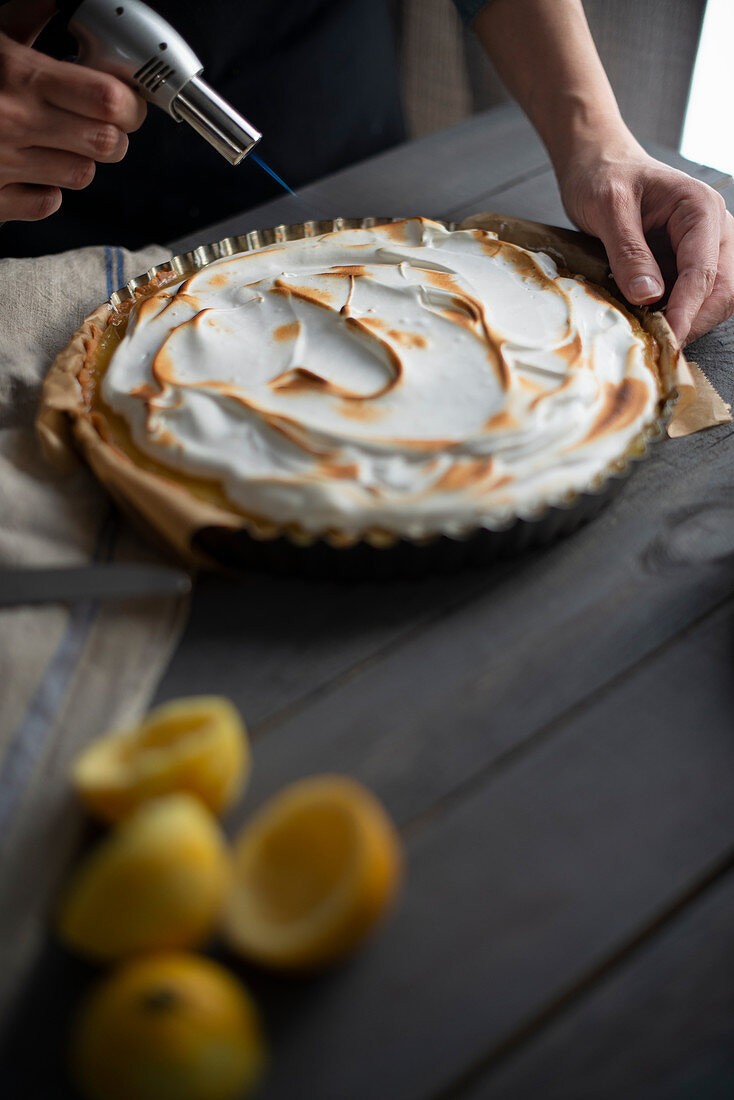 Meringue topping on a lemon tart being scorched