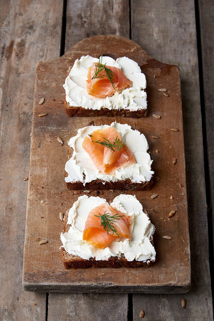 Wholemeal spelt bread slices topped with cream cheese and smoked salmon