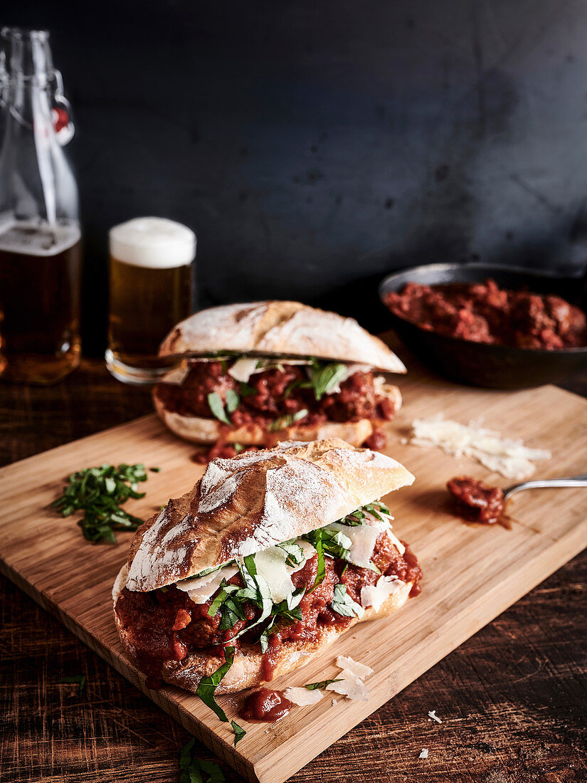 Baguette rolls with meatballs in tomato sauce, basil and parmesan