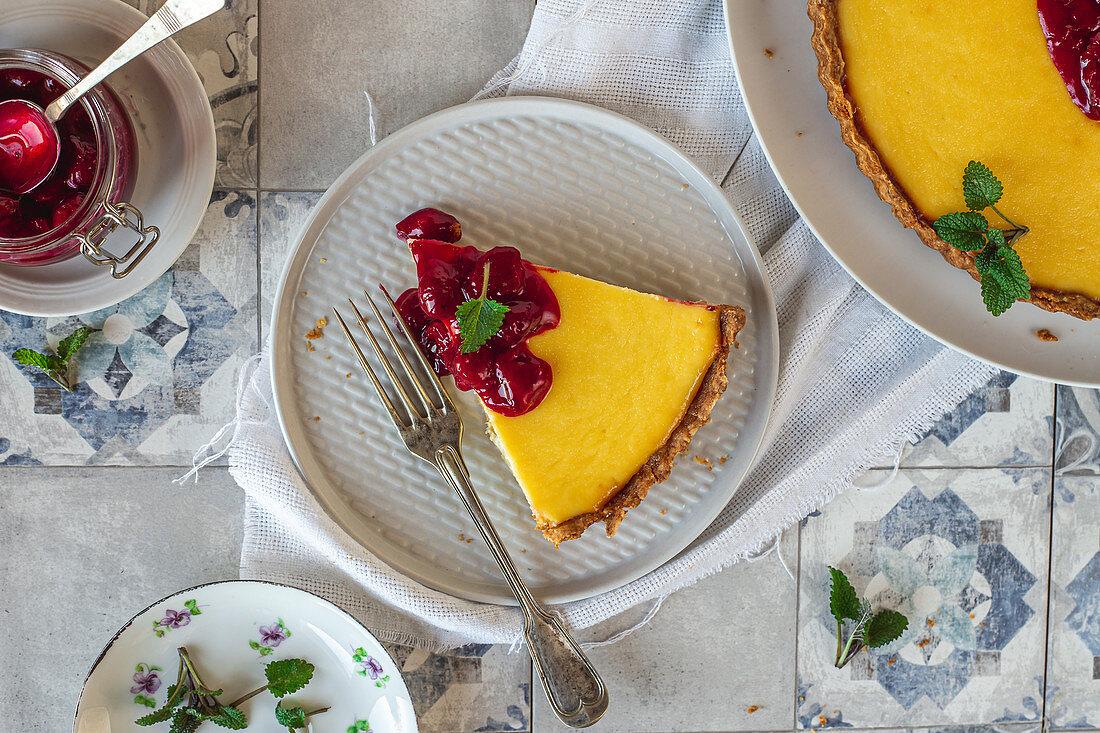 Ricotta pie with sour cherries sauce
