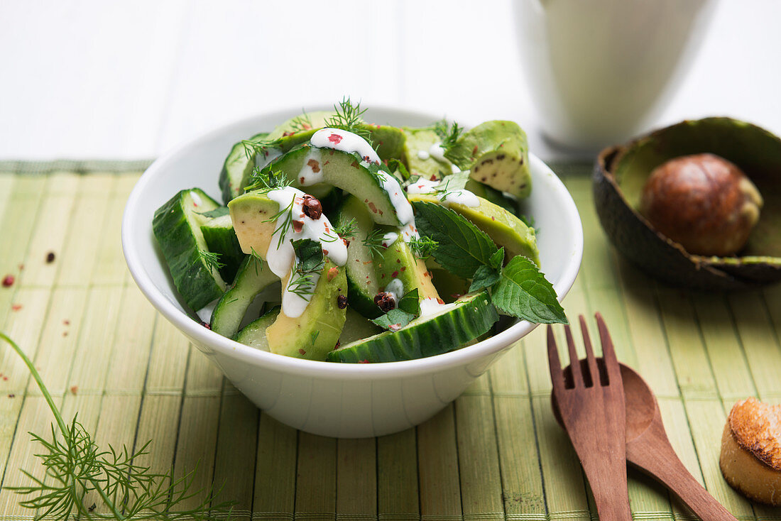 Avocado and cucumber salad with soy yogurt and mint dill dressing