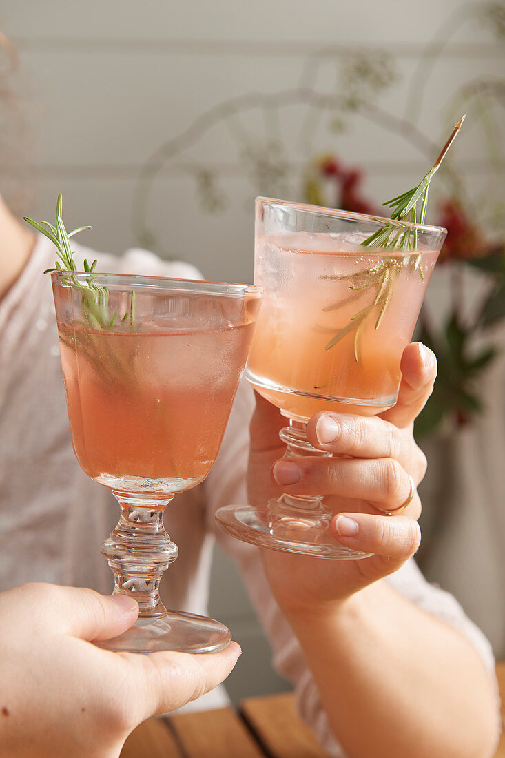 Pink fizz with rosemary sprigs