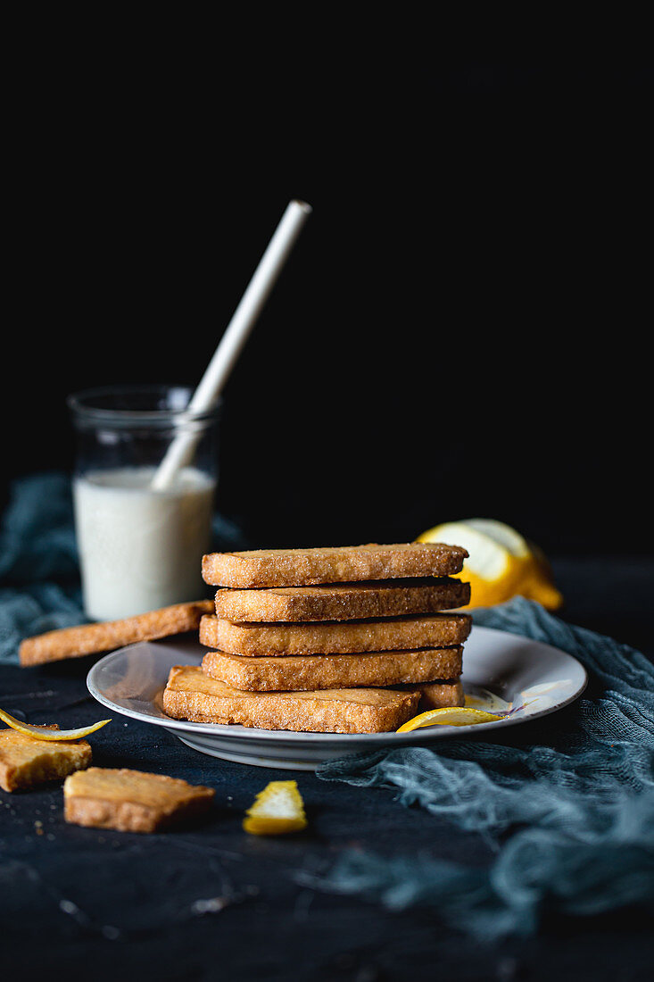 Square polenta cookies on white plate
