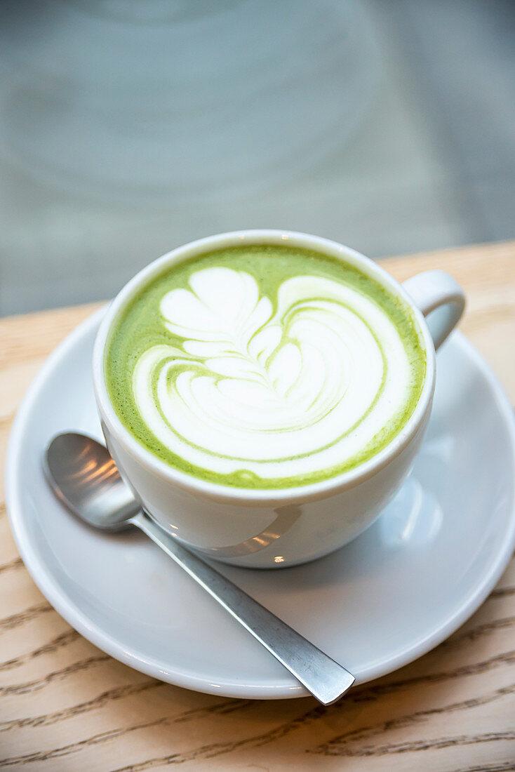 Cup of matcha green tea latte