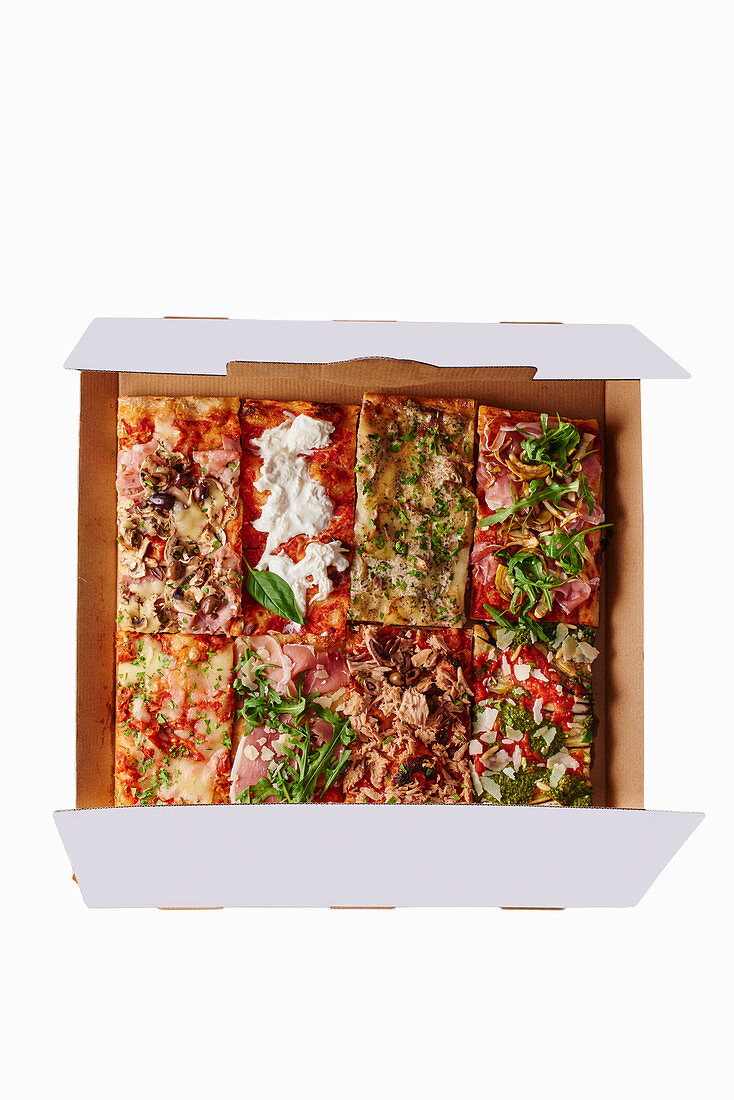 Various pieces of pizza in a box