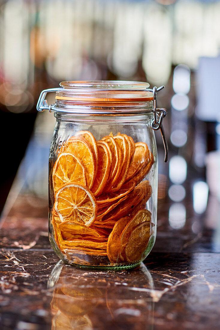 Dried orange slices in a mason jar