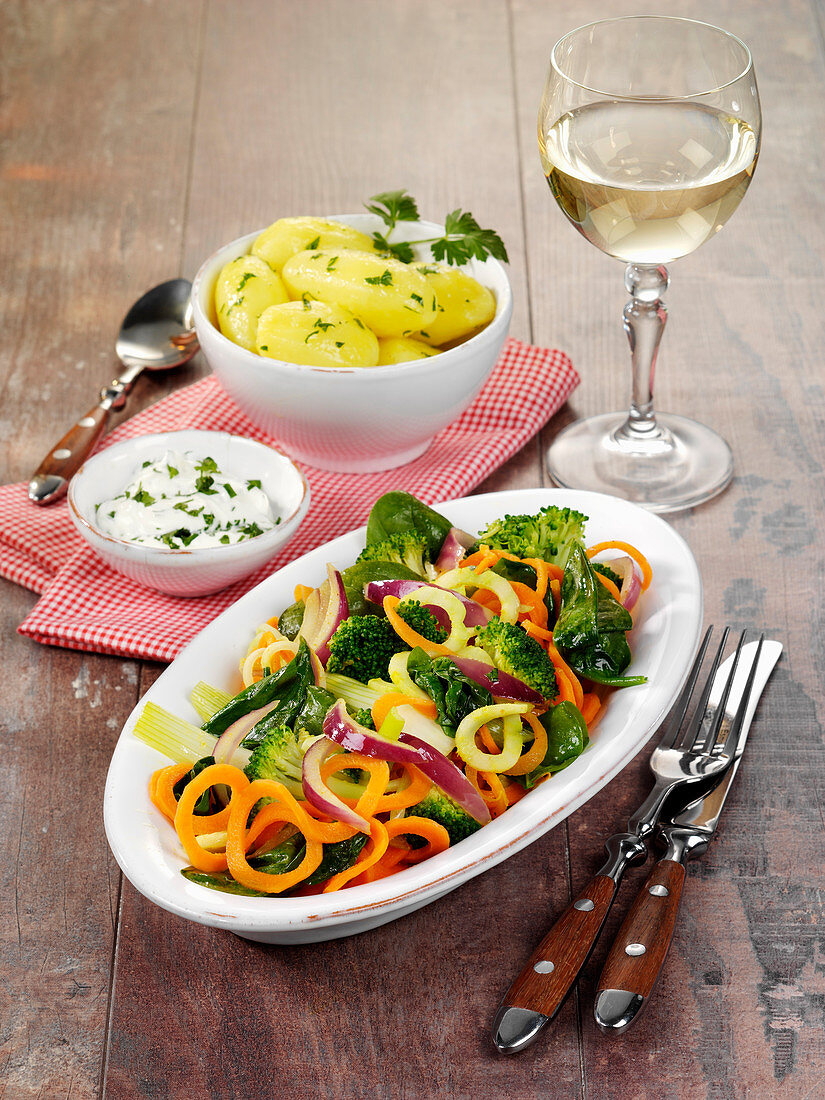 Sautéed broccoli with parsley potatoes and yoghurt