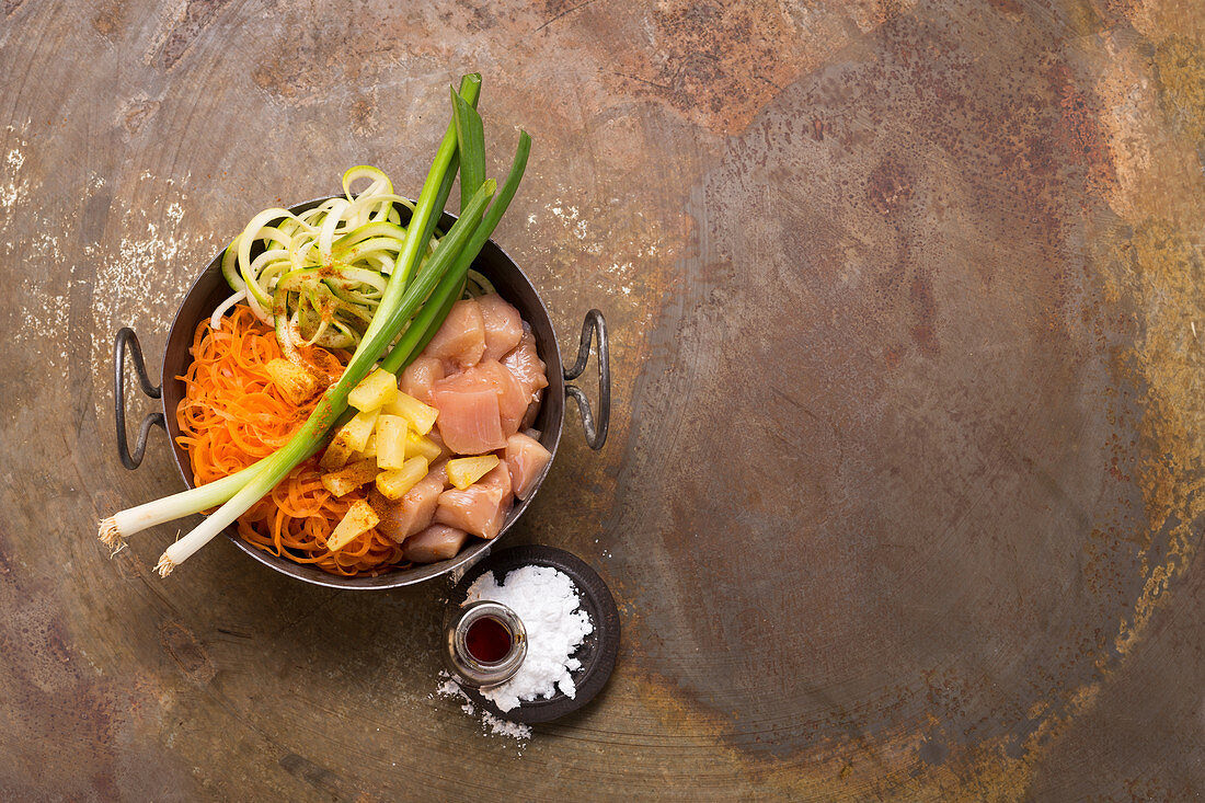 Ingredients for sweet and sour chicken with pineapple, coodles and zoodles