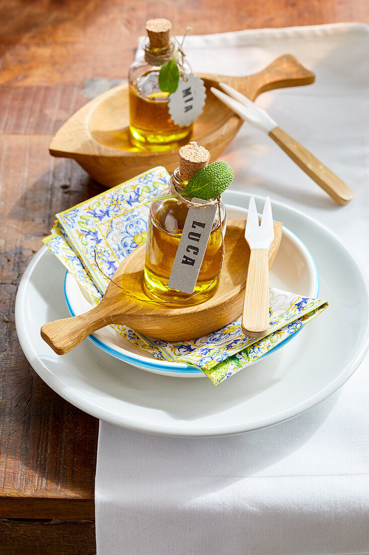 Small bottles of oil on Mediterranean place setting