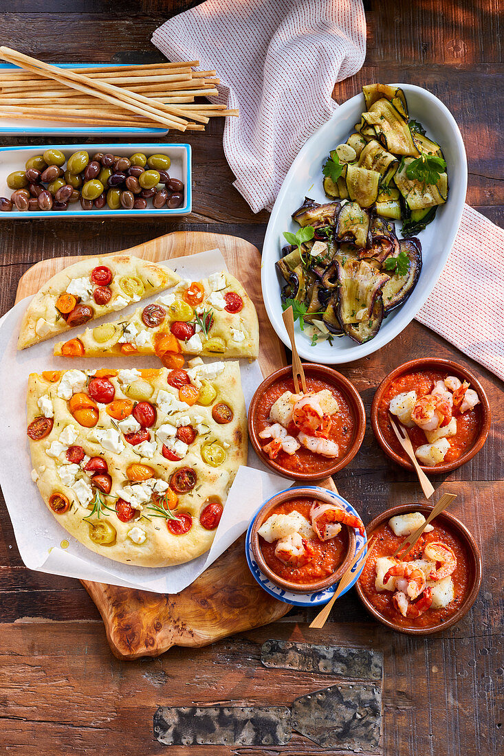 Focaccia with tomatoes, marinated eggplant and seafood