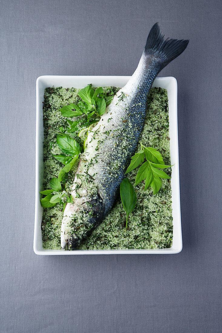 Sea bass in a green tea salt crust with Mitsuba pesto