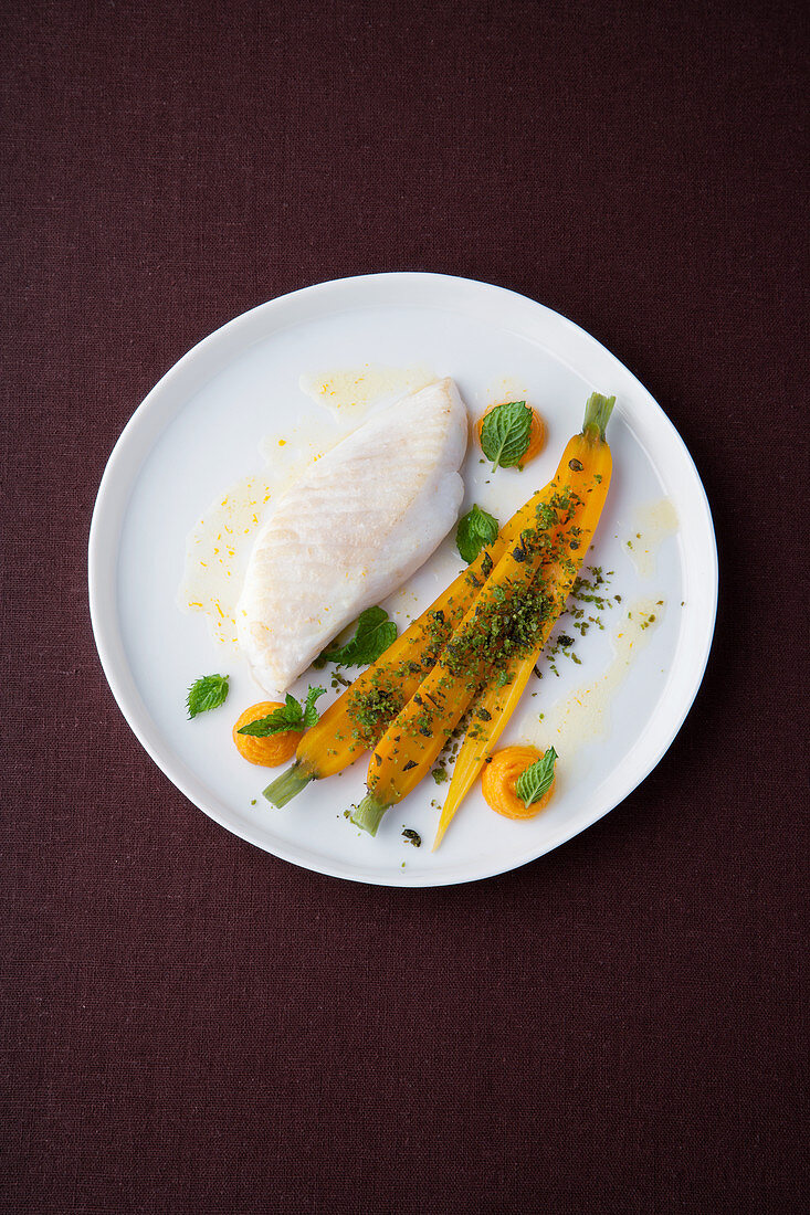 Dory with mint oil, carrots and pistachio crumbs