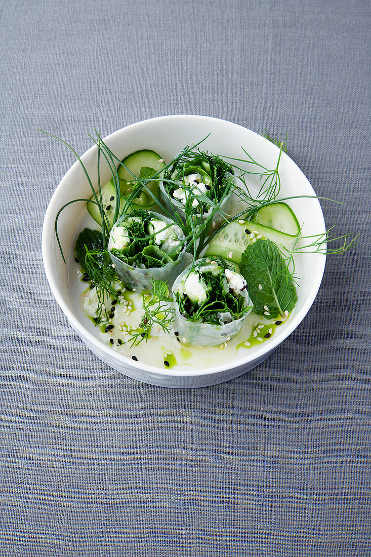 Rolls of rice paper with mint, buffalo ricotta and beard