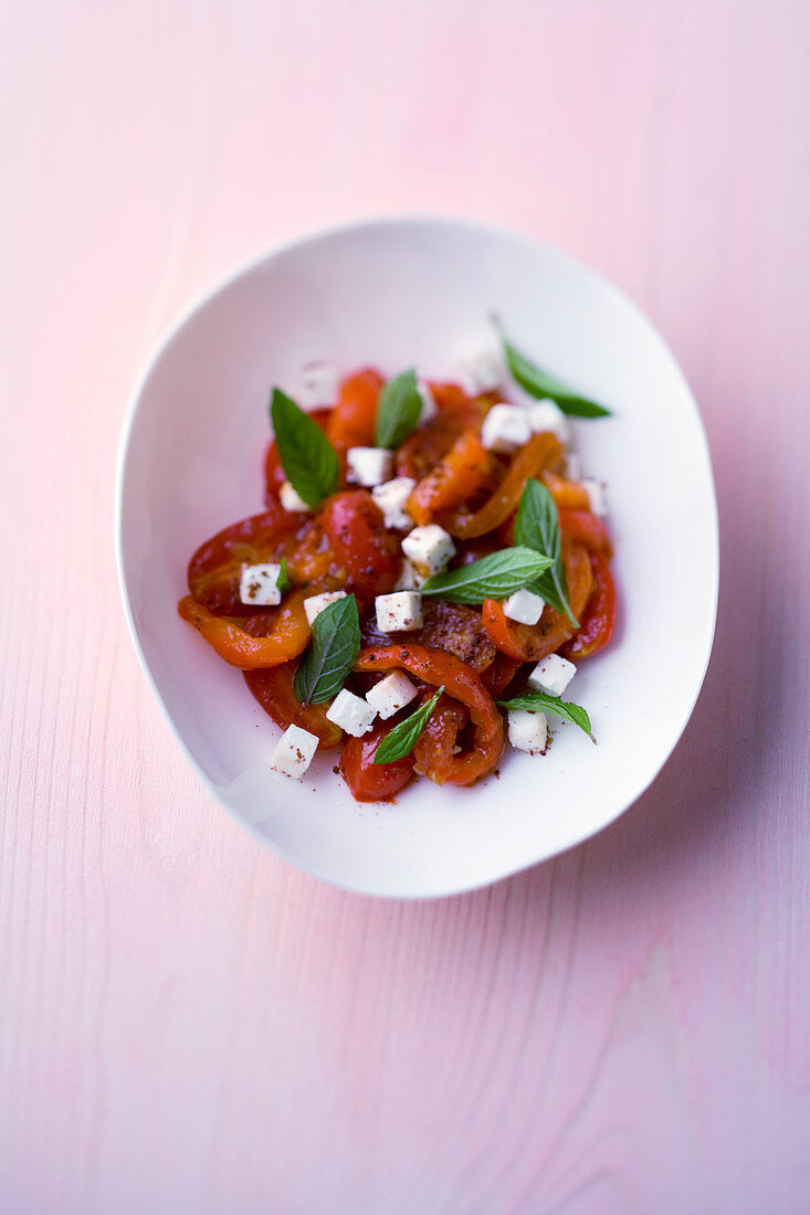 Roasted tomato and pepper salad with feta and grains of paradise