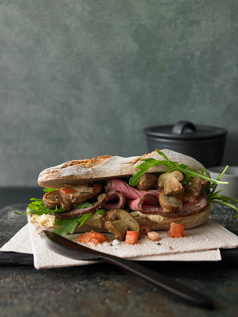 Roast veal and mushroom sandwich in hummus dressing