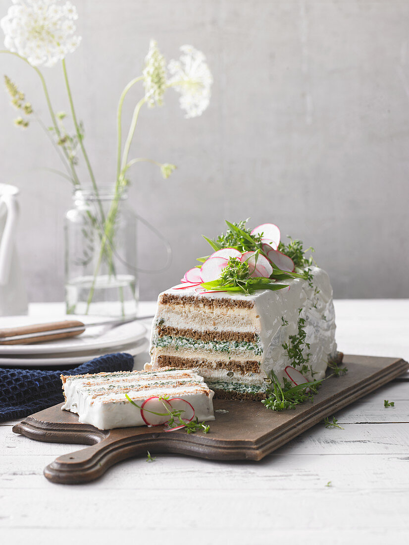 Savoury sandwich cake with radishes and herbs