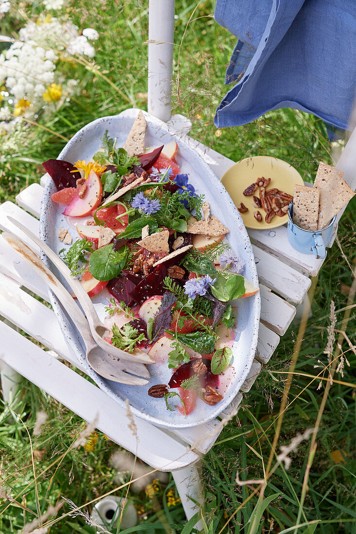 Wild herb salad with beetroot, apple, grapefruit and nuts
