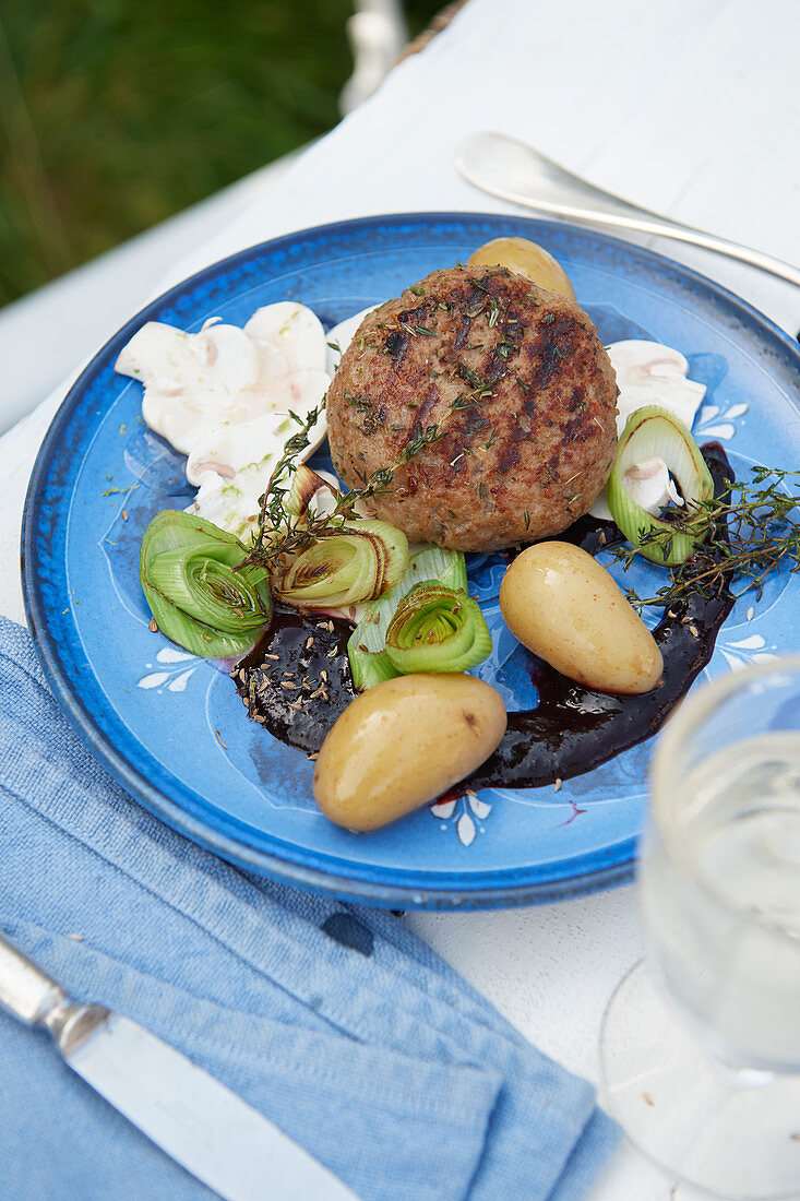 Grilled veal meatballs with blueberry sauce and marinated mushrooms