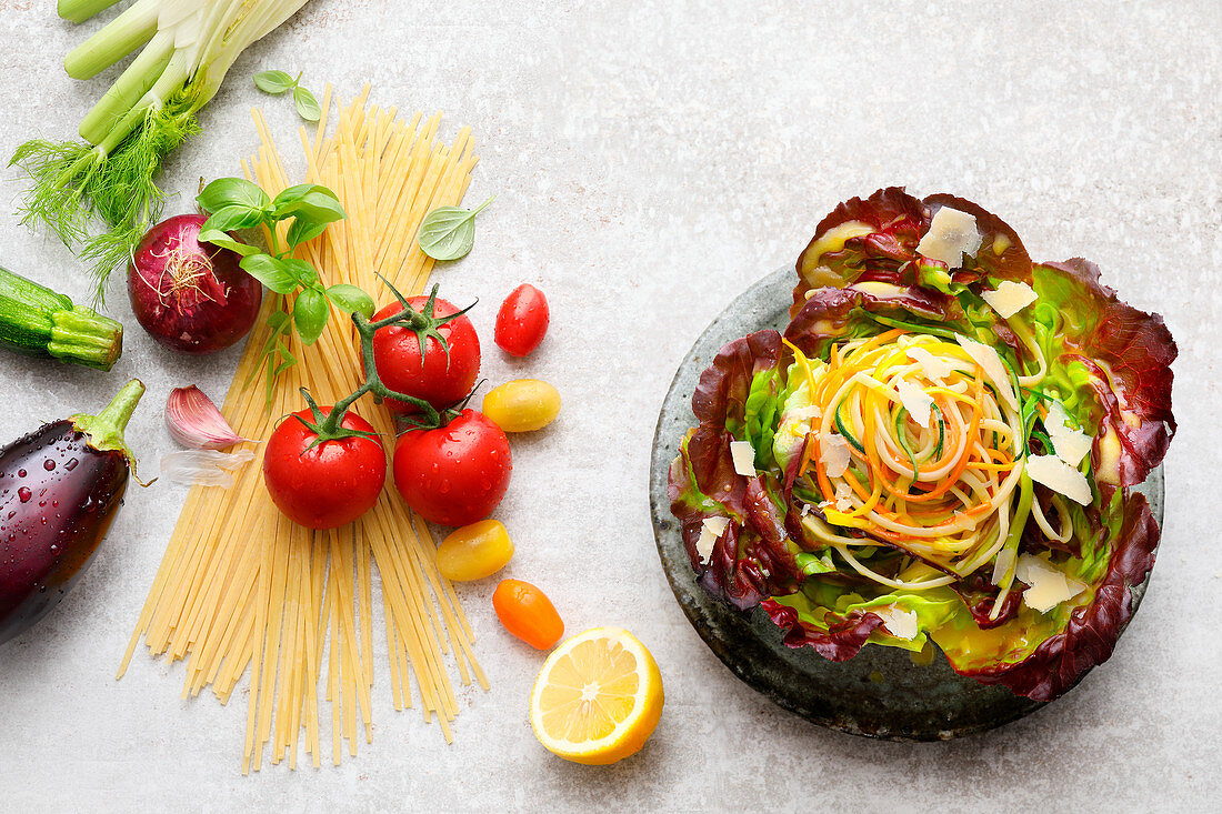 Vegetable noodle salad next to ingredients