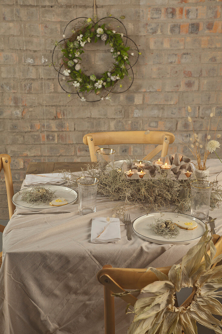 Easter table rustically set with natural materials in shades of grey