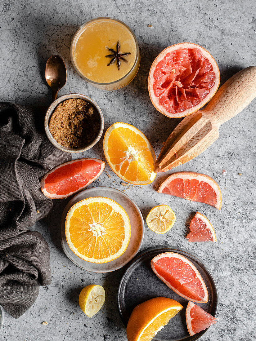 Wintry citrus drink with cinnamon and brown sugar
