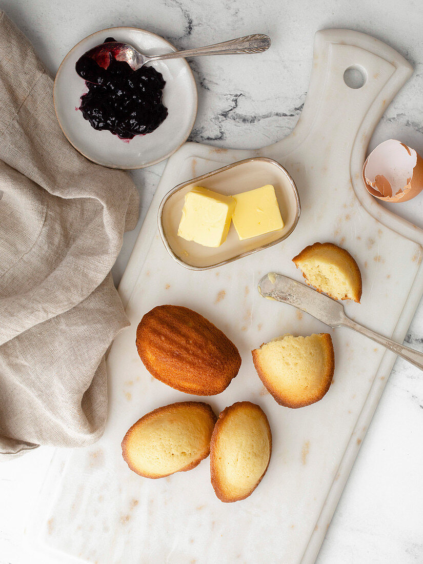 Madeleines served with butter and jam