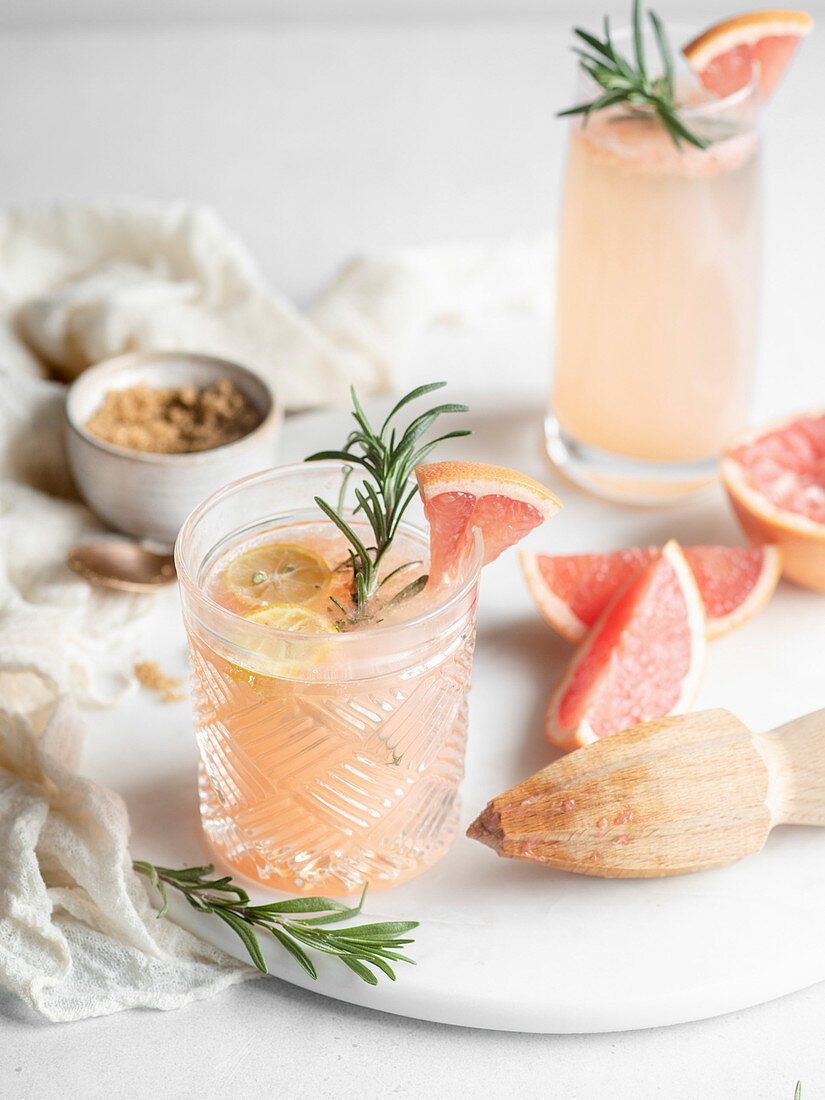 Pink grapefruit drinks with rosemary