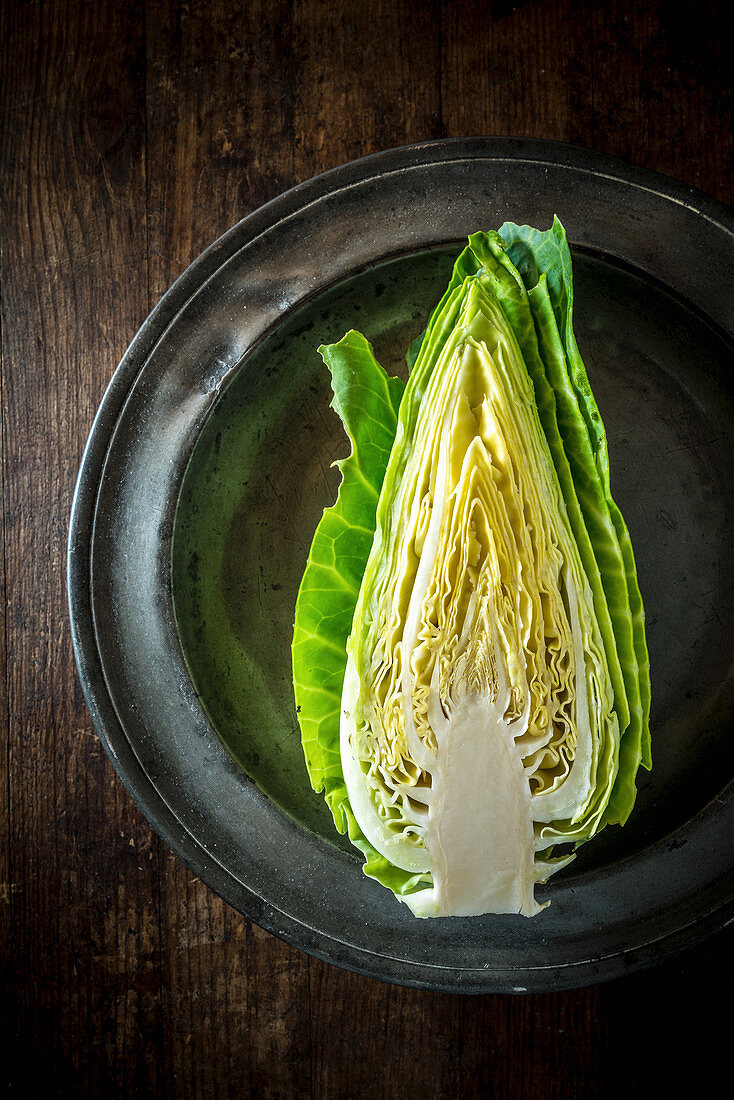 Half Cabbage on a metal plate