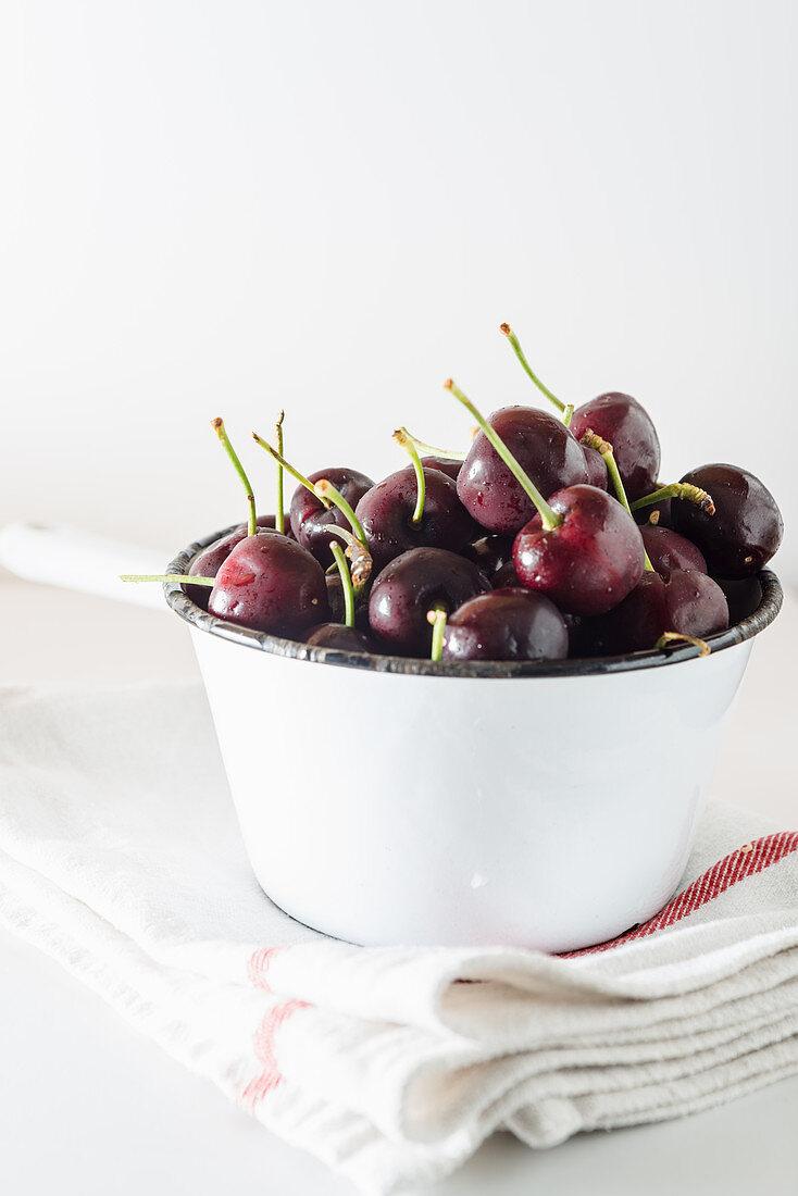 Cherries in White enamel pan