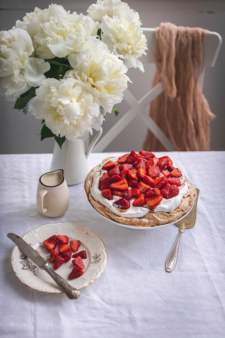 Pavlova cake with whipped cream and strawberries