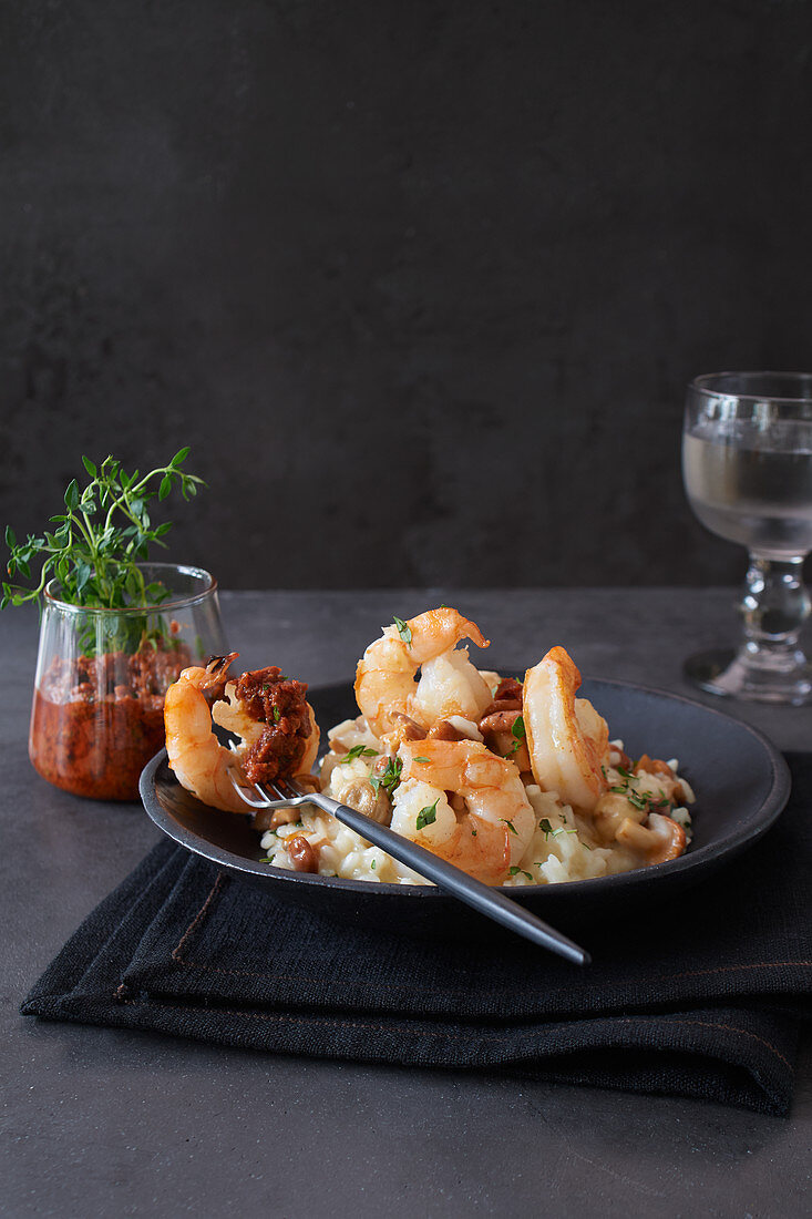 King prawns on mushroom risotto with red pesto