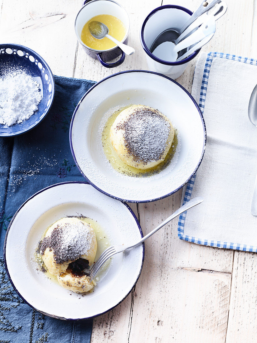 Germknödel (yeast dumpling filled with plum jam) with butter and poppyseeds