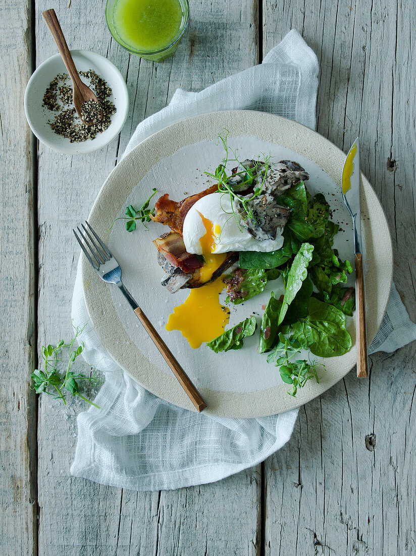 Warm Spinach salad with poached egg and mushrooms
