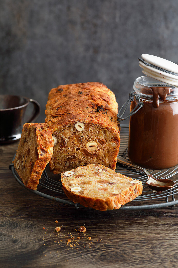 Apple and nut bread with chocolate sauce