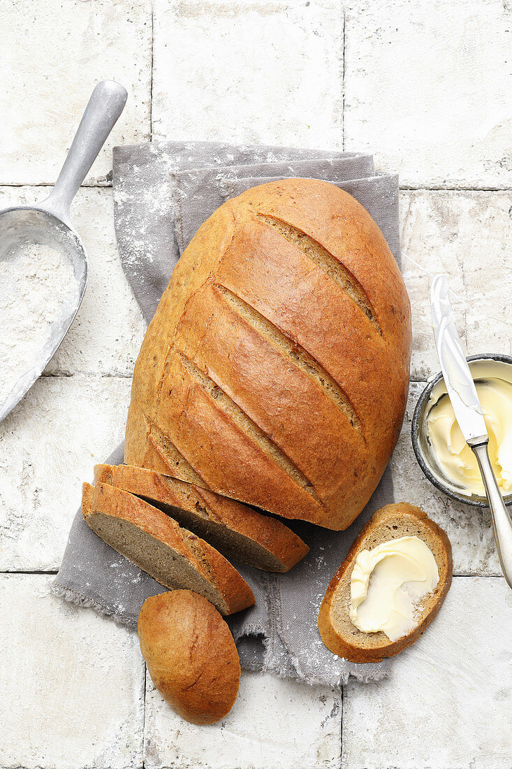 A loaf of homemade rye bread, sliced