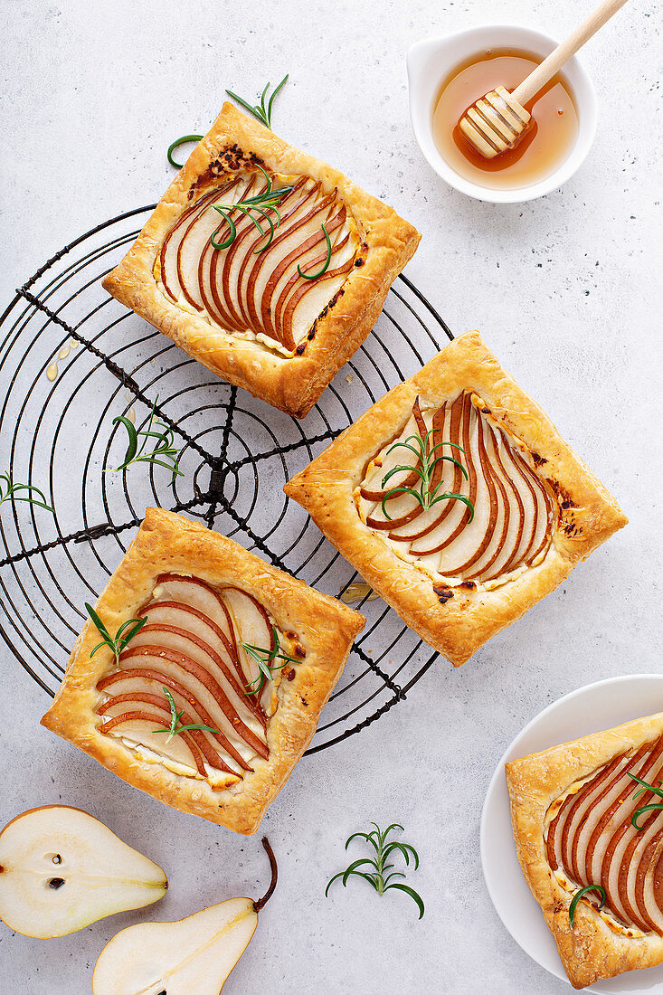 Pear and rosemary puff pastries with honey