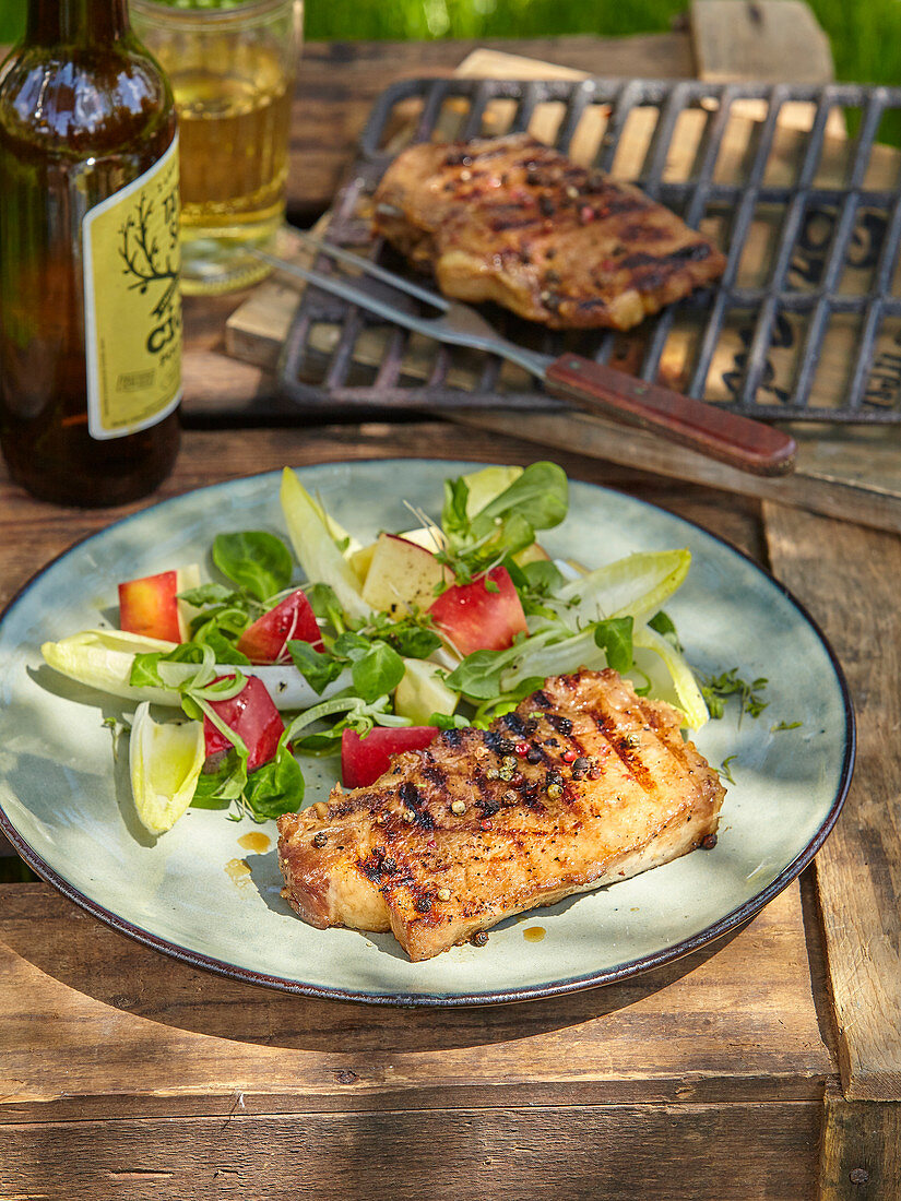 Pork chops in apple marinade with salad